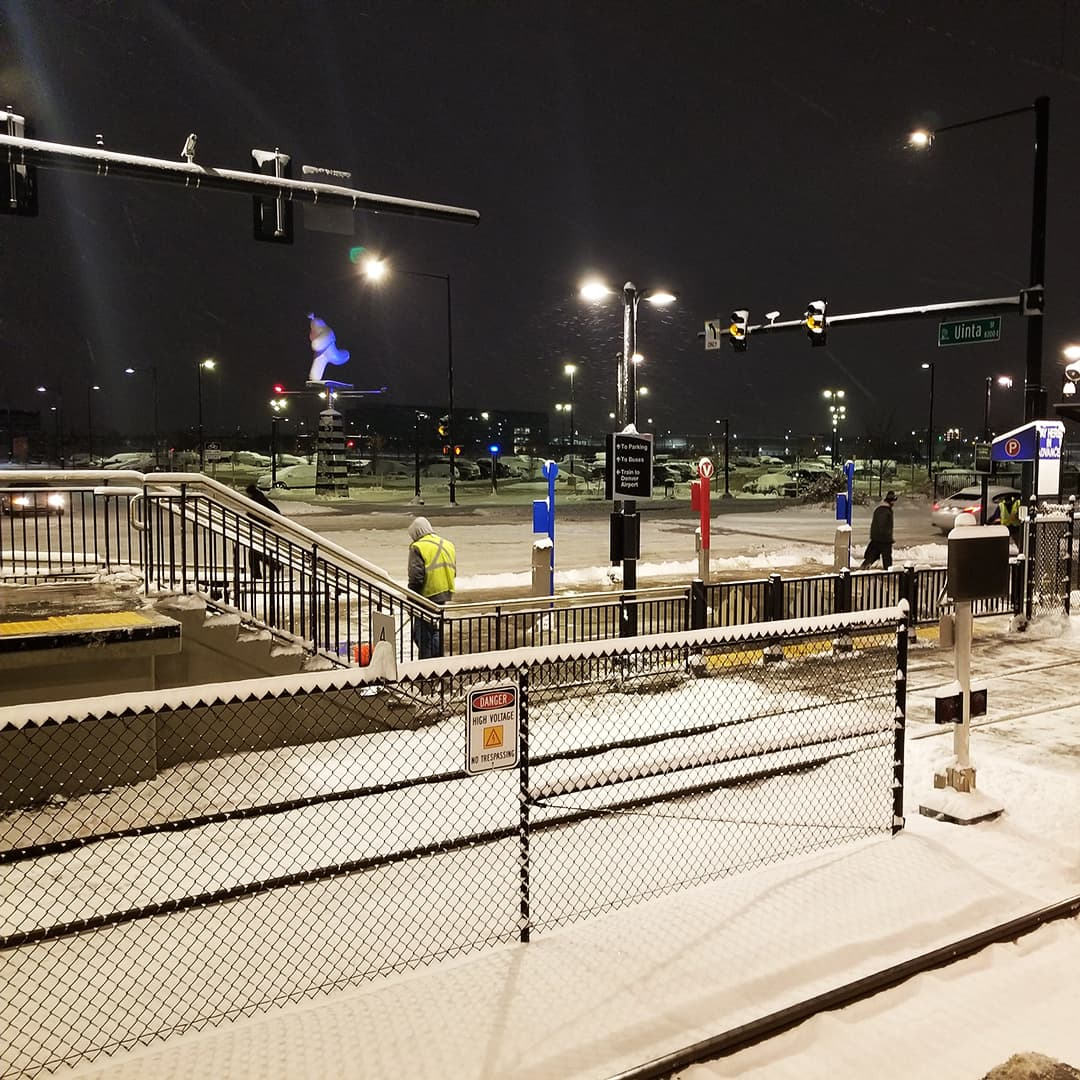 Facilities and maintenance crews clearing snow from RTD station