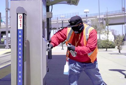 Employee cleaning ticket vending machine