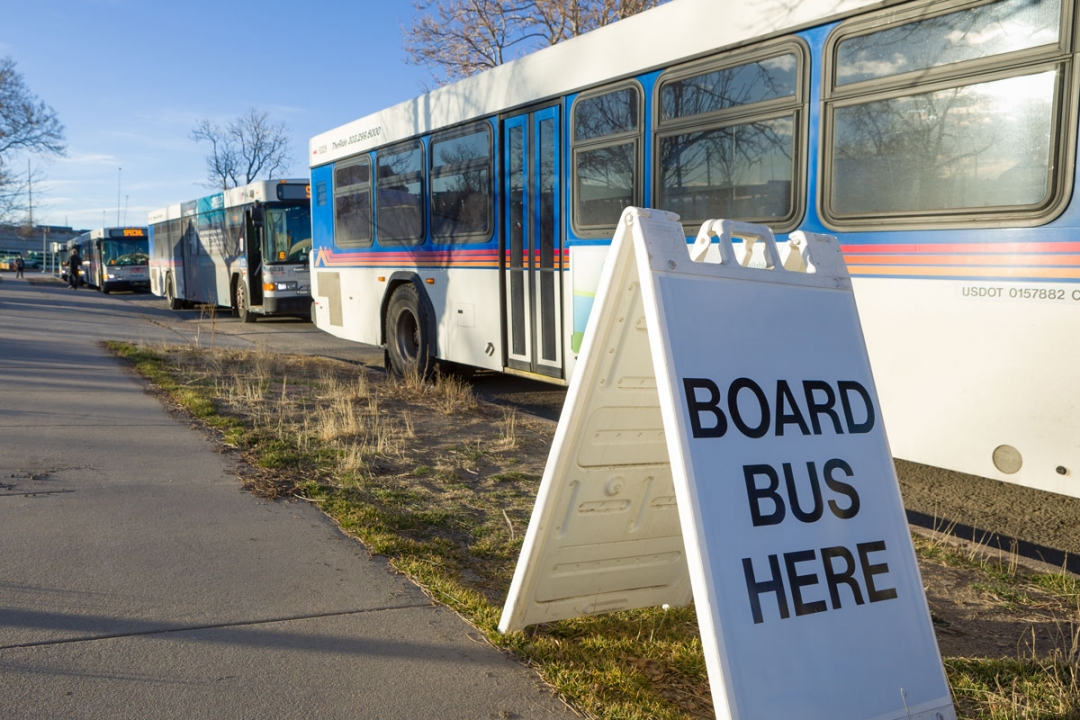 """Board Bus Here"" sign at SCL Health COVID-19 Vaccination Event"