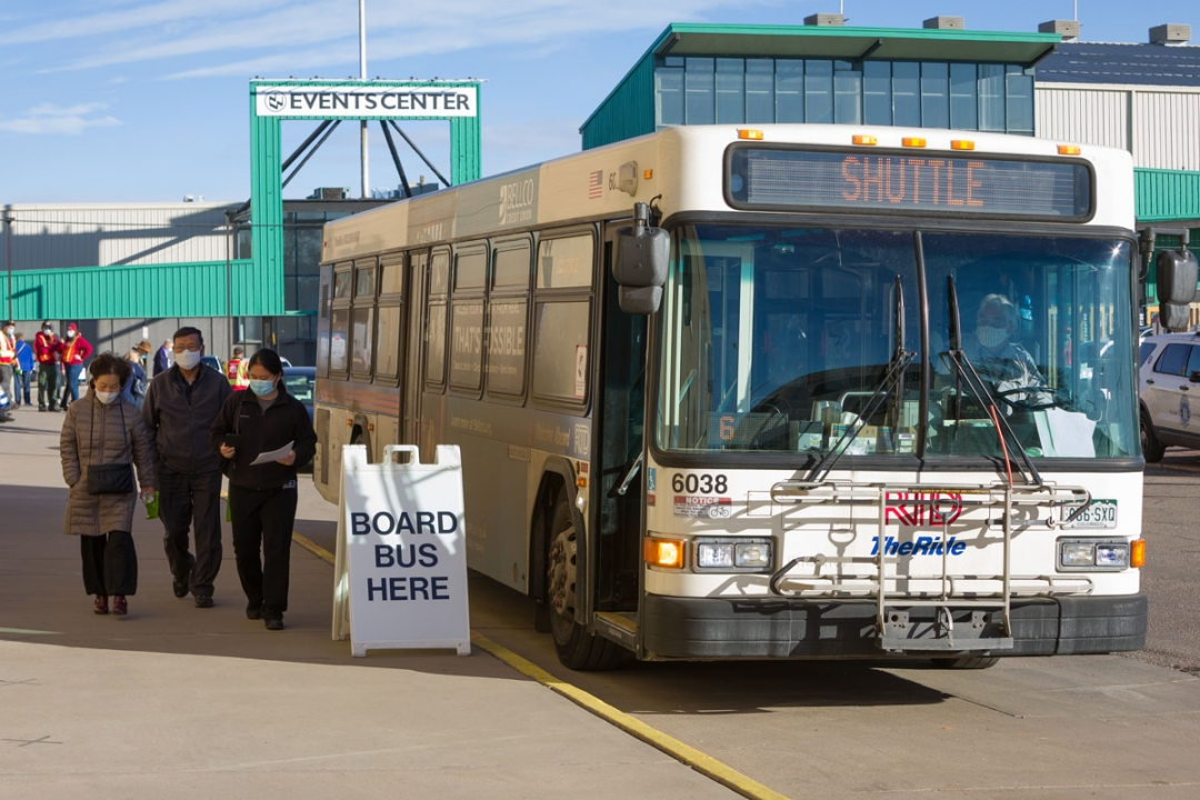 RTD Bus Shuttle with masked passengers at SCL Health COVID-19 vaccination event