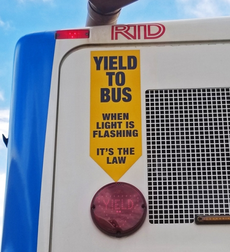 Yield to Bus when light is flashing. It's the law.