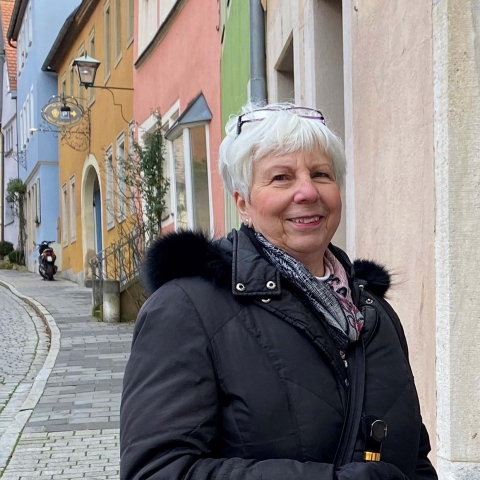 Sherry Ellebracht on a street with colorful houses